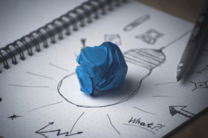 blue clay on light bulb sketch for business growth